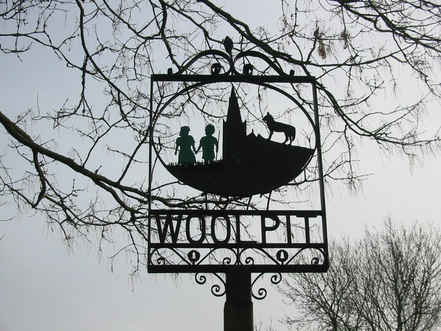 Mysterious people from other worlds:The green children of Woolpit-the_village_sign